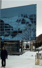 Mt Racey reflected in the exterior of Hotel Mt Racey. Mike Richards photo, uploaded by Mike Pow  [Mount Racey, Yubari City, Hokkaido]