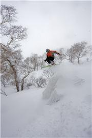 Sean Archer going ballistic off the back of the Super Ridge. Photo - Mark Tsukasov., uploaded by NisekoNow  [Niseko Mountain Resort Grand Hirafu, Kutchan Town, Hokkaido]