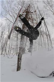 Downsie lives up to his name by getting up in the air and down in the powder. Photo - Randy Wieman, uploaded by NisekoNow  [Niseko Mountain Resort Grand Hirafu, Kutchan Town, Hokkaido]